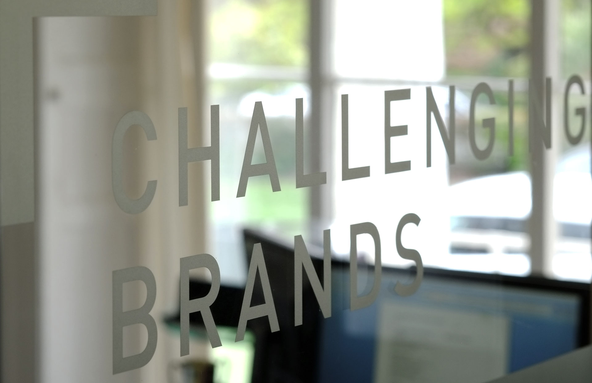 challenging brands marketing sign