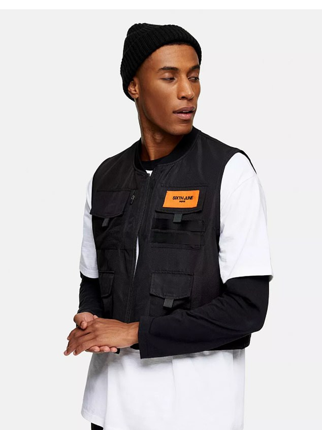 Topman model wearing a mock stab proof vest demonstrating it as fashion