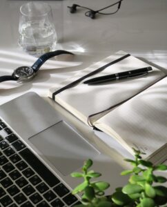 laptop notebook and pen